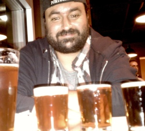 E-Rock has smiled over pints and samples of beer all year long, in between his various musical gigs.