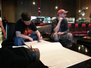 Stoutmeister, left, writes down the trivia answers while Porter Pounder does, um, something important.