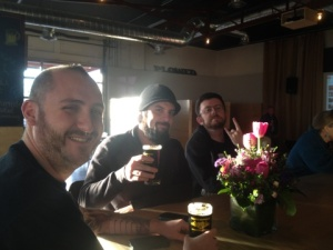The Crew enjoys their first pints at Tractor's new Wells Park taproom. From left, Porter Pounder, Brandon, Stoutmeister.