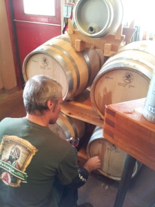 Brewer Rod Tweet pours a small sample of Flemish Red from the barrels inside Second Street Brewery.