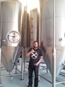 Gabe Jensen rocks the awesome Scotia Scotch X-Men-style shirt in the brewery.