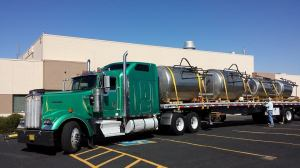 We borrowed this photo from Red Door's Facebook page showing their brewing tanks being delivered.