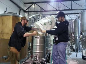 Porter Pounder, left, and Stoutmeister work on our beer at Tractor Wells Park.