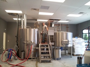 Brewer John Bullard sits atop his throne, er, brewhouse, after finishing his first batch of beer on the new system.