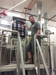 Brewer Justin Hamilton is all smiles with his shiny new brewhouse at Boxing Bear Brewing.