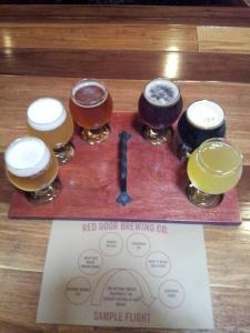 The first Red Door sampler, from left, Gateway Blonde, Hairy Mit Hefe (Boxing Bear), Threshold IPA, Roamer Red, Paint it Black Milk Stout, Unhinged Cider.