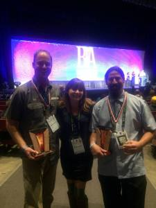 Marble's trio of brewers posed with their medals and awards in Denver. (Photo courtesy of Marble Brewing)