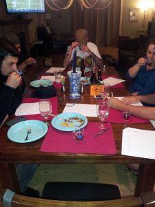 The Crew carefully studies their Oktoberfest samples.
