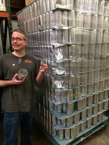 Doug shows off the new crowlers that you will soon be able to fill with purchased beer at Canteen.