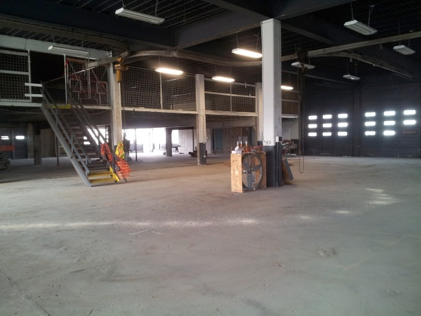 The massive interior of Rio Bravo, looking east to west. The taproom will be on the far west side, extending underneath the visible mezzanine, which will have storage to the left and a private tasting area to the right.
