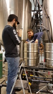 Brandon, left, getting in the way gathering social media content while Franz stirs in the mash.