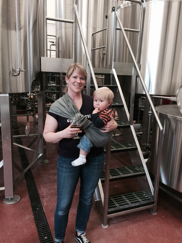 La Cumbre co-owner Laura Erway helps keep the brewery running while also raising future co-owners Owen, pictured, and Miles.