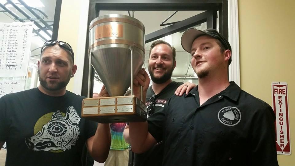 The winning team of Bosque co-owners Jotham Michnovicz, left, Gabe Jensen, center, and brewer John Bullard, right.
