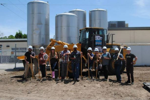 That is one happy brewery staff now that this project is finally underway. (Photo courtesy of Marble's Facebook page)
