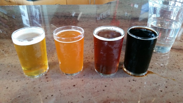 The first half of the flight, from left, Little Bird Blonde, Big House Belgo, Red Hammer, Black Point Stout.