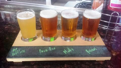 A flight of local beer is available at Rock & Brews.