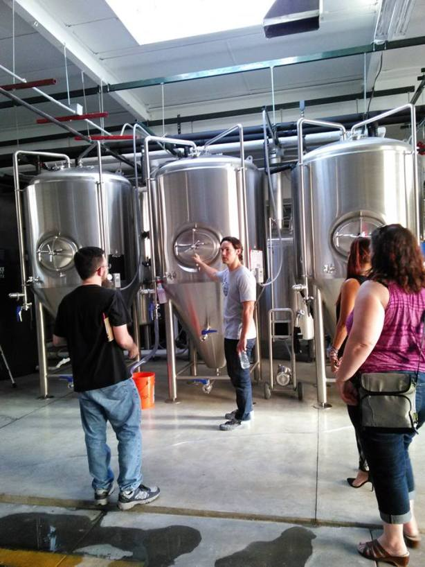 George Boese gives the Crew a tour of the brewery.
