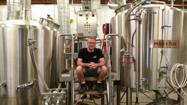 Brewer Doug Cochran is all smiles atop his new 15-barrel brewhouse throne at Canteen.
