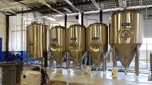 The current lineup of fermenters and the hot liquor tank on the left.