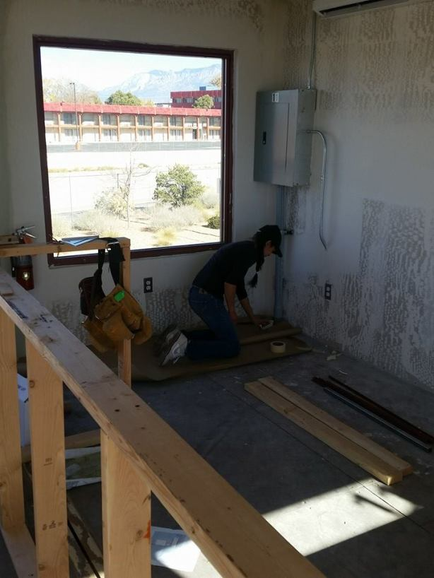 The staff is hard at work preparing Distillery 365's new tasting room at the Green Jeans Farmery.