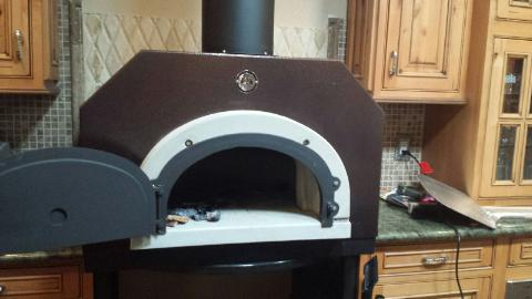 The new wood-fired pizza oven should be fired up in the next month.