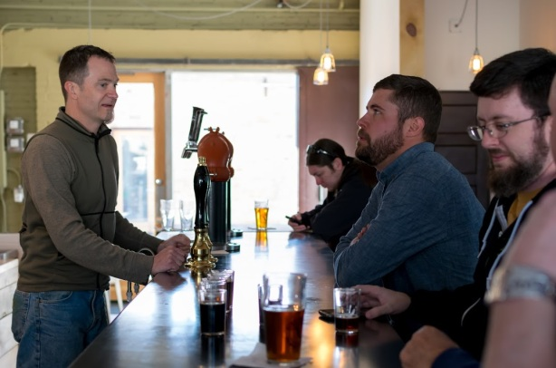 Sidetrack's Dan Herr serves Red Door brewmaster Wayne Martinez, while a certain beer writer has a weird look on his face to the far right.