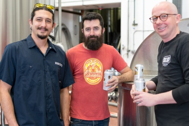 The brewer in the center of this photo, Tim Woodward, is changing breweries later this month. (Photo by Mario Caldwell)