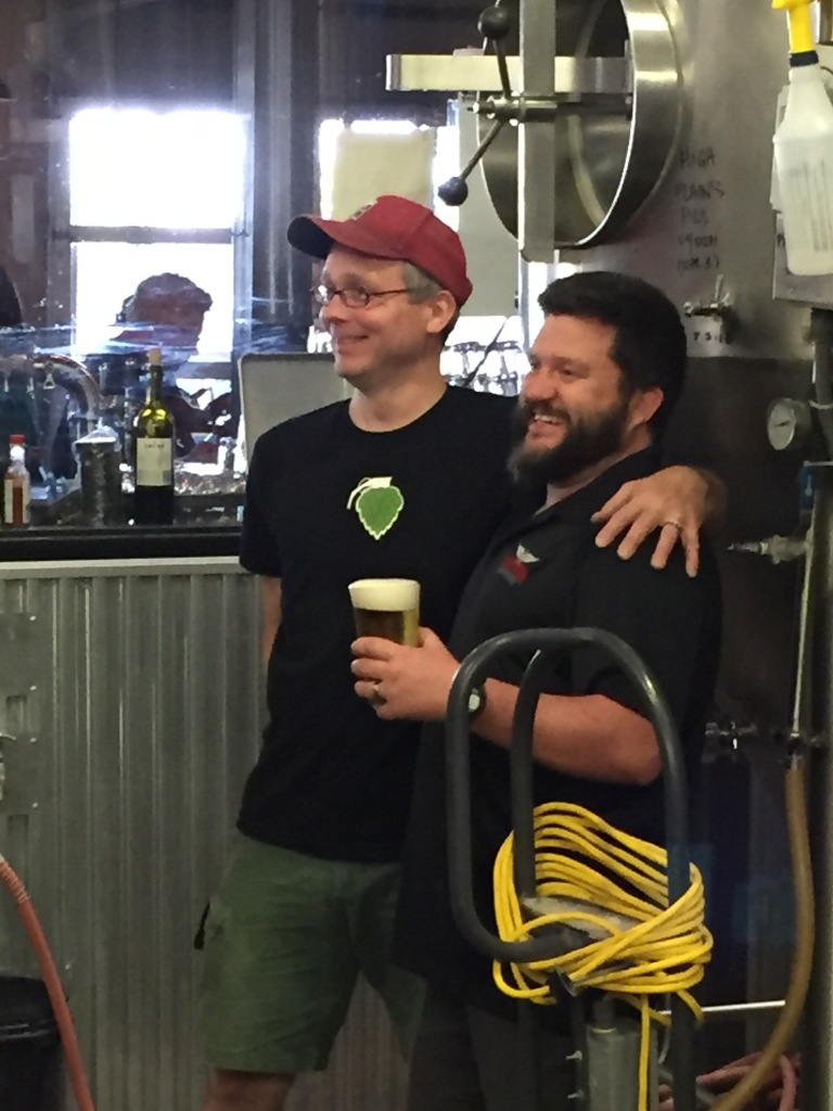 Brewers Doug Cochran, left, and Zach Guilmette react at Canteen after learning their High Plains Pils won a silver medal at the World Beer Cup.