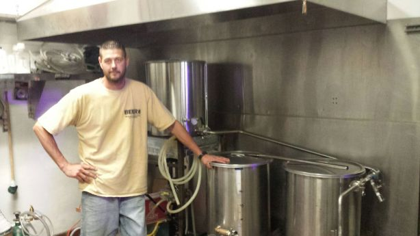 Brewer Ben Couger is quite proud of the 1-barrel system they use to create small batches at the Alien Brew Pub.