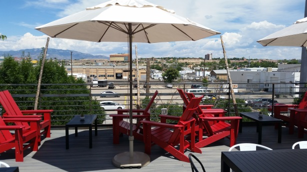 "Looking east toward the Sandias, with the ""lounge area"" tables and chairs."