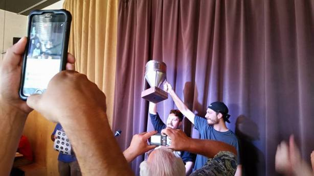 Amid a sea of people taking pics on their cell phones, the Boxing Bear brewing team holds their NMIPAC trophy aloft!