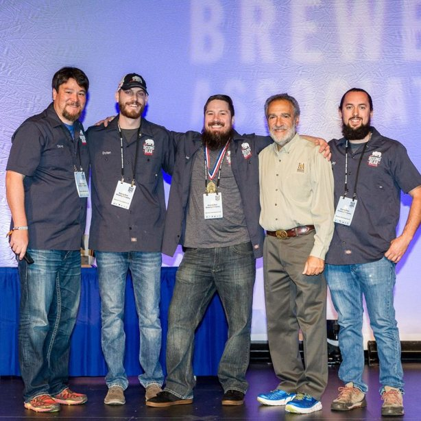 The team with Charlie Papazian after winning gold for The Red Glove. (Photo courtesy of the Brewers Association)