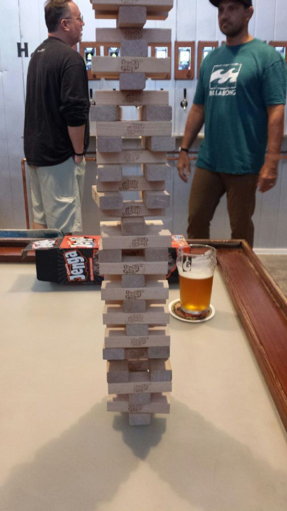 Behind the ubiquitous Giant Jenga, note those two watch-like devices on the wrists of the customers. That's what keeps track of your beer pours.