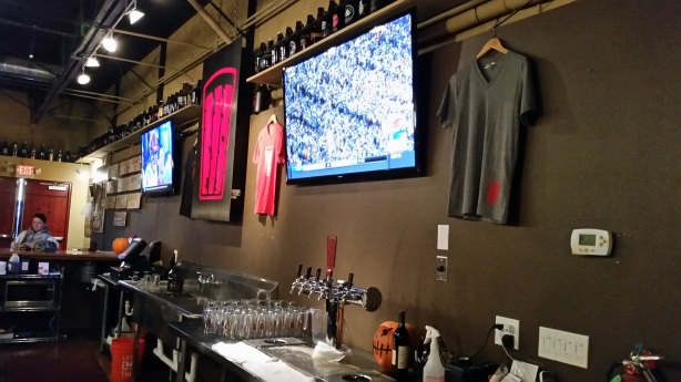 The shirts on the wall are just a few of the items available at Red Door.