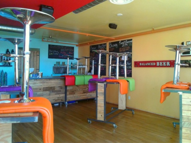 The colorful interior of the Kaktus taproom.