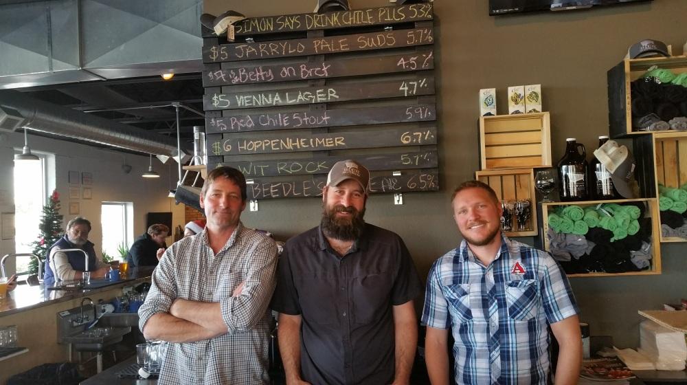 Incoming GM Doug Osborn, outgoing GM Jason Fitzpatrick, and head brewer Nic Boyden.