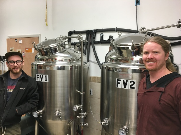 Zach, left, and Patrick have been keeping their small brewing system humming.