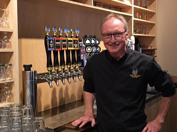 Thomas Baxter, an actual monk from the Monastery of Christ in the Desert, is often serving beers at Monks' Corner downtown.