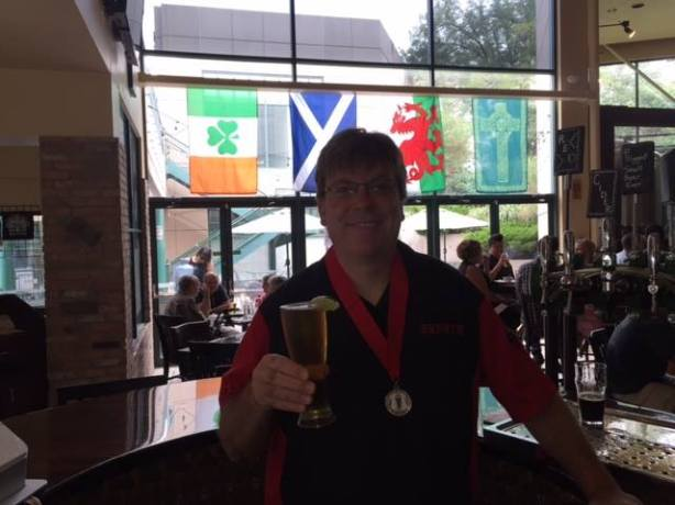 Brady shows off his silver medal from the North American Beer Awards for that there Pedro O'Flanagan. (Courtesy of QC)